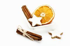 cinnamon stars, cinnamon sticks and dried orange slices - stock photo