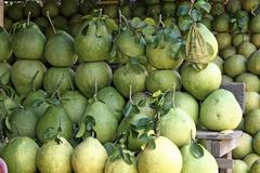 pomelos (citrus maxima), market stall, floating market, damnoen saduak, near  - stock photo