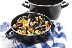 Mussels and vegetable in a saucepan Stock Photos
