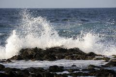Breaking waves near el cotillo, fuerteventura, canary islands, spain, europe Stock Photos
