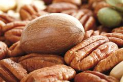 pecans and mixed nuts, full format - stock photo