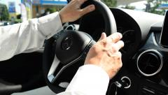 Switching speed and turn the steering wheel in a Mercedes - stock footage