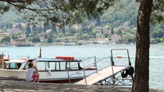 Lake Lago Maggiore Italy The girl waiting for the boat Stock Footage