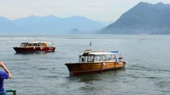 Lake Lago Maggiore Italy boats on the water taxi out Stock Footage