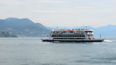 Lake Lago Maggiore Italy. Ship boat ferry glides through the water Stock Footage