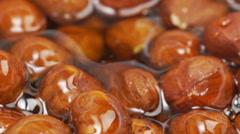 Hazelnut in honey Stock Footage