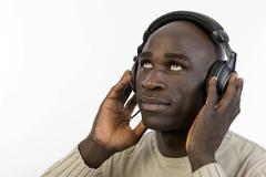 Dark-skinned man, 30, wearing headphones Stock Photos