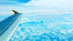 Bright view of the clouds and the wing from the aircraft cabin Stock Footage