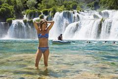 Woman, 35 years old, bathing in the krka waterfalls, krka national park, dalm Stock Photos