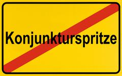 Town exit sign, german lettering konjunkturspritze, symbolic of end of boost  Stock Photos