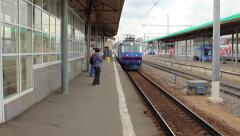 Train arrives on moscow railroad station and arrival of the train - stock footage