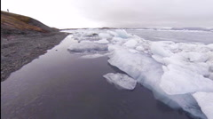 Jokulsarlon, flying close to the ice - stock footage