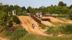 Riding a dirt bike over the hill Stock Footage