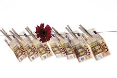 Euro banknotes hanging from a clothesline, counterfeit money, duds Stock Photos