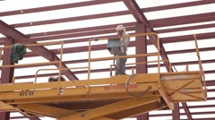 Metal construction building and worker Stock Footage