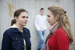 rivalry between two teenage girls - stock photo