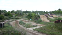 Motocross course with dirt bikes racing against each other Stock Footage