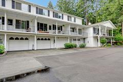White residential building in classic style. view of garages and driveway Stock Photos