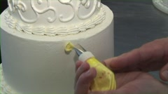 Wedding Cake Decorating with Yellow Flowers Stock Footage