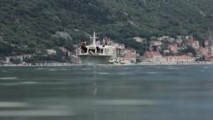 Beautiful seascape with ship and speed motor boat. Ship passes through the bay. Stock Footage