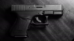 a gun on a table - stock footage