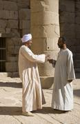 Stock Photo of two nubian men gesticulating in debate, new-kalabscha, lake nasser, egypt