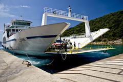 The ferry sailing between the isle of krk and cres in croatia Stock Photos