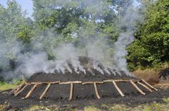 glimmering charcole pile in siegerland near netphen, north rhine-westphalia,  - stock photo