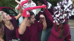 tailgating football fans cheering for their team - stock footage