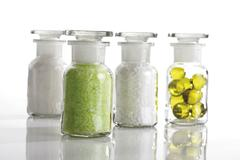 Bathing products in chemist\'s bottles, bath pearls, bath salts Stock Photos