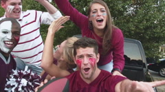 Tailgating football fans cheering for their team Stock Footage
