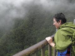 Stock Photo of woman wearing waterproof clothing, on the mirador espigon atravesado viewing