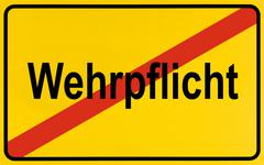 Stock Photo of town exit sign, german lettering wehrpflicht, symbolic of end of compulsory m