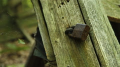 Old rusty lock on abandoned house. Stock Footage