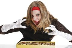 Stock Photo of young woman with a desire for filled chocolates