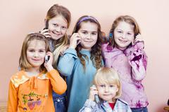 Group of children, girls from left 6, 11, 9 and 9 years old, boy 4 years old, Stock Photos
