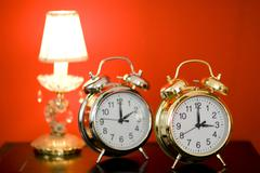Daylight-saving time, summer time, winter time, right alarm clock in focus Stock Photos