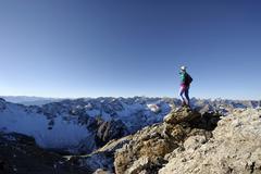 alpinist in front of alpine panorama, gramais, lechtal, reutte, tirol, austri - stock photo