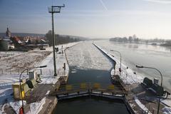 frozen watergate, no shipping traffic possible, aschaffenburg, bavaria, germa - stock photo