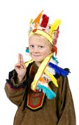 5-year-old boy dressed up as an american indian, peace greeting Stock Photos