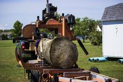 Log ready for cutting on portable sawmill  Stock Photos