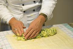 cooking course, making a savoy cabbage strudel, forming the strudel, germany, - stock photo