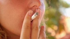 Closeup of Young Woman Smoking. Stock Footage