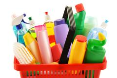 Shopping basket with detergent bottles and chemical cleaning supplies isolate Stock Photos