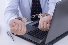 Businessman in handcuffs, symbolic picture for business crime Stock Photos