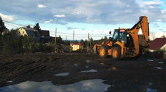 Excavator clearing road construction site, Petrozavodsk Stock Footage