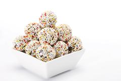 Stock Photo of rum truffles with coloured sugar sprinkles in white bowl
