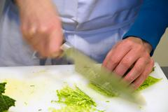 cooking course, making a savoy cabbage strudel, cutting the savoy cabbage, ge - stock photo