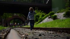 Child walking on Trails Stock Footage