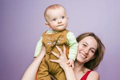 Smiling young mother, 25 years old, and her son, 7 months old Stock Photos
